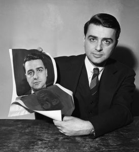 21 Feb 1947 --- 02/21/1947: Picture shows Edwin H. Land showing positive and negative print taken from a new camera that produces finished pictures. --- Image by © Bettmann/CORBIS